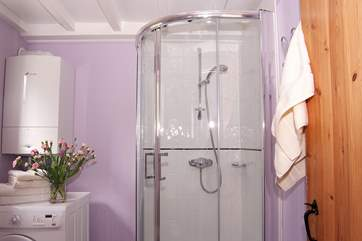 The modern shower-room doubles as a useful utility-room.