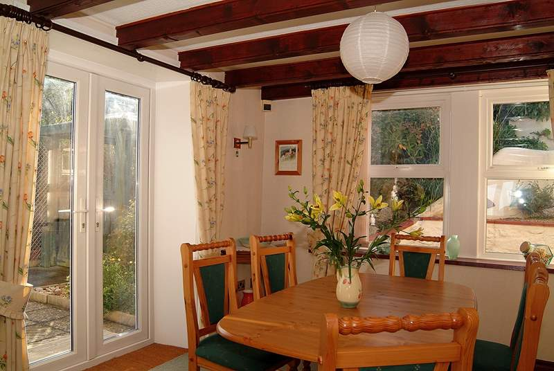 The dining-area has French windows onto the garden.