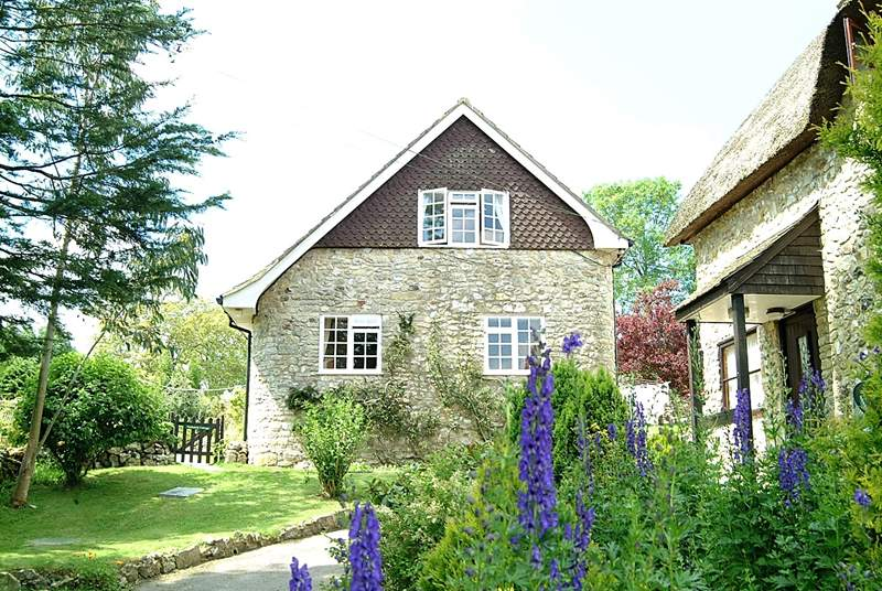 Nuthatch Cottage is to the side of this historic farmstead, with wonderful views down the valley.