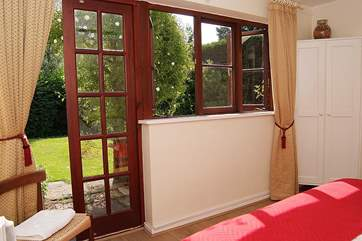 The master bedroom, Bedroom 1, has French windows to the enclosed private garden.