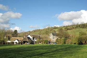 The cottage is to the left of the photograph, nestled in the hamlet of Ibberton.