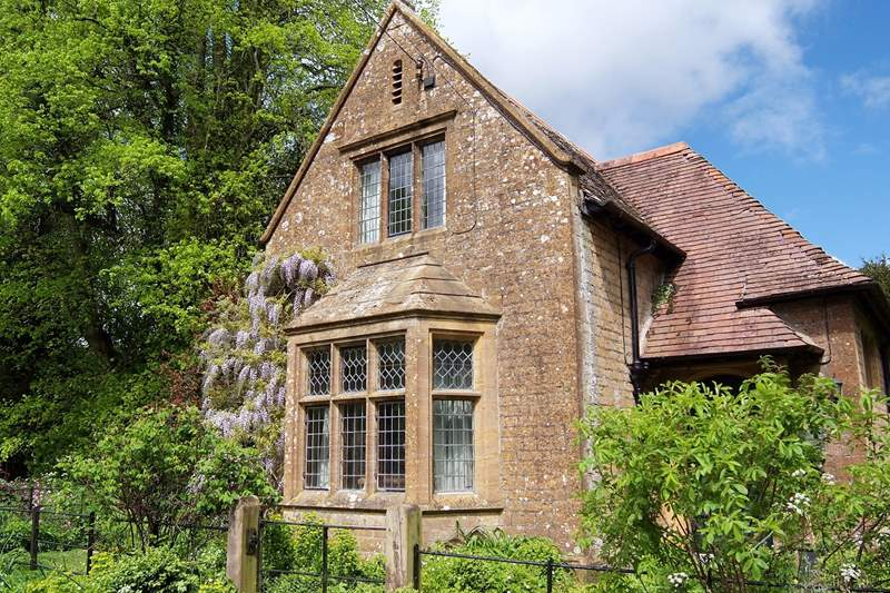 The view of the cottage on arrival - as you drive through the stone pillared entrance for this original gate-house.