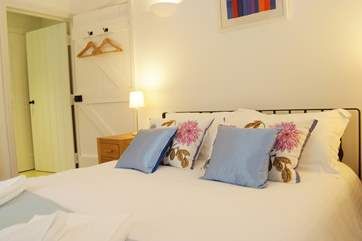 Crisp white bed linen and attractive furnishings in both bedrooms.