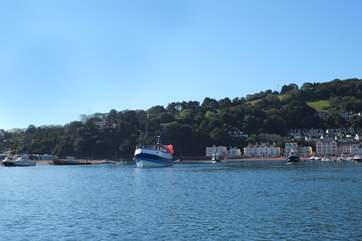 Fishing boats coming in through the estuary mouth to tie up in Teignmouth.