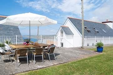 The raised garden terrace has views out to the bay at Sennen Cove.