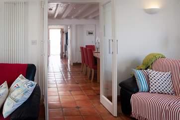 Looking back towards the front door and kitchen across the lovely terracotta floor tiles