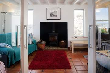 The wood-burner in the sitting-room will keep you toasty on those cooler evenings.