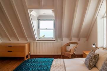 The master double bedroom has wondeful views out to sea.