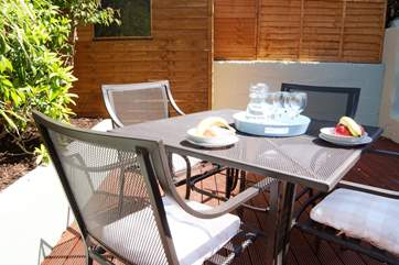 ... and just outside there is a really sunny decked-area where you can enjoy your breakfast, gin and tonic or whatever you fancy! You are on holiday!