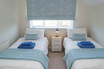 The twin bedroom is lovely and fresh, ideal for young children or a couple.