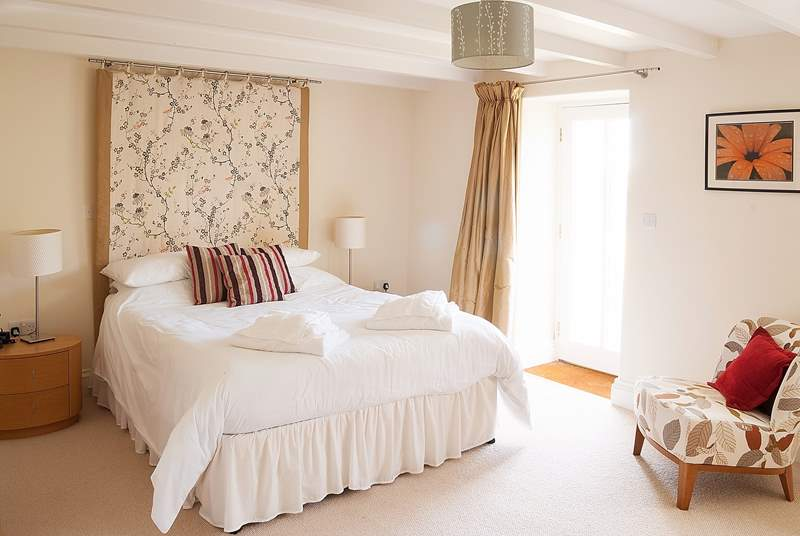 The gorgeous master bedroom with a door onto the garden.