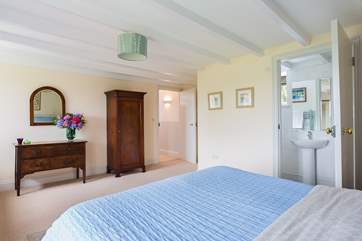 The spacious en suite master bedroom is along the hall from the other rooms on the lower ground floor.