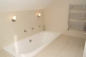 The bathroom with sunken bath.