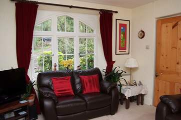 There is a lovely large window in the sitting-room.