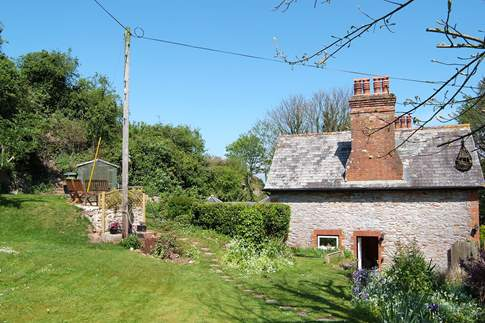 Berry Head Cottage is on the left, one of a pair of Edwardian cottages.
