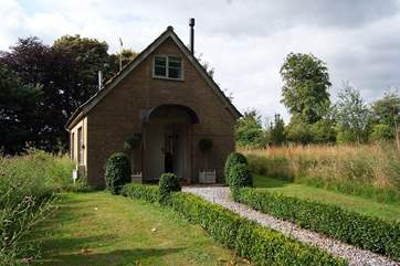 The front of The Pump House with its lovely box hedges.