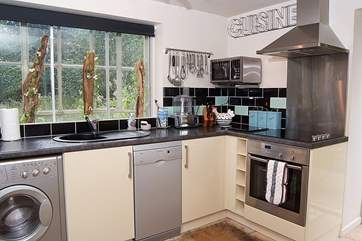 The kitchen is cleverly fitted into one corner of the open plan ground floor.