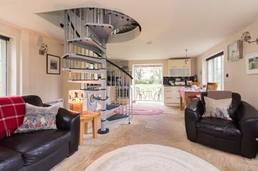 The open plan layout of the ground floor means that this gorgeous bolt-hole is filled with light.