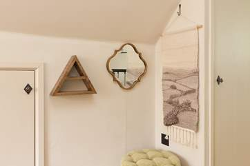 There is even a thoughtful corner in the bedroom with mirror, make-up shelf and stool.