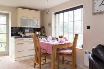 The dining table looks out over your very own wildlife and wild flower meadow.