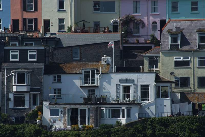 White Cottage is set into a hill, with a Juliet balcony outside the window of the second floor bedroom, a large terrace and a further terrace on the ground floor.