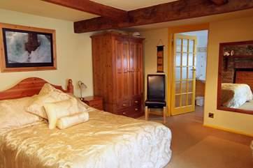 The ground floor double bedroom (Bedroom 1),  has its own en suite bathroom.