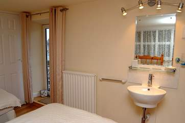 Bedroom 2 on the first floor also has views of the harbour.