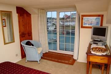 Bedroom 3 on the top floor has views of the harbour.
