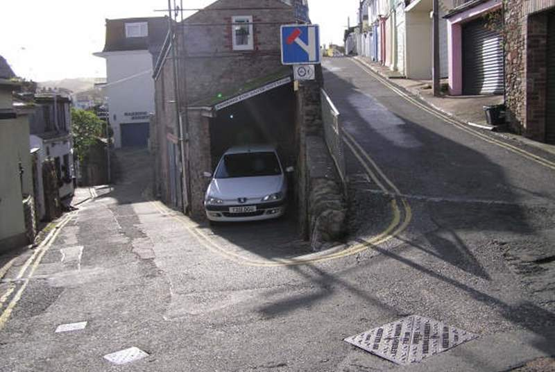 This shows the car sparking space on the right for a small car only and we would recommend reversing in. The shallow steps down to the cottage are three yards down on the left.