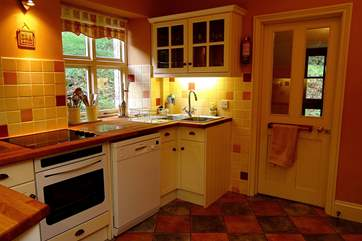 The kitchen has a utility-area through the door  which is ideal for the dog's basket.