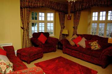 The sitting-room has comfortable sofas and a double-sided wood-burner.