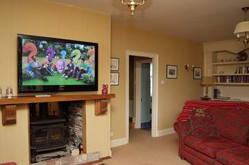 There is a large plasma television in the sitting-room.