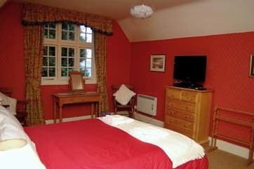 One of the attractive double bedrooms (Bedroom 1), which has views towards the water.