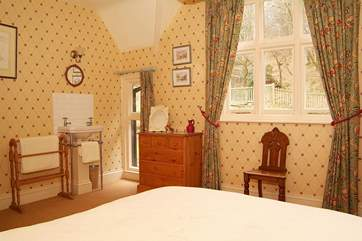 With a dual-aspect, this double bedroom (Bedroom 2) is very light and also has a wash-basin.