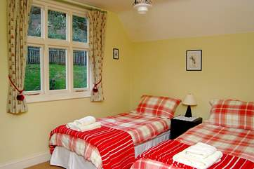 A view of this double bedroom (Bedroom 2), which looks out over the garden and woodland.