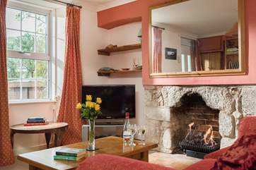 The sitting room is a cosy, comfortable and relaxing space.