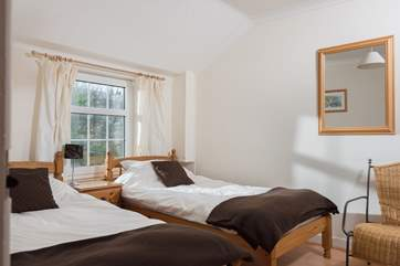 The twin room overlooks the pretty garden to the rear of the cottage.