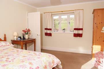 The double bedroom has countryside views on both sides