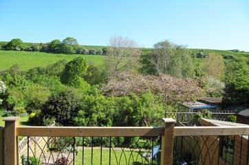 The decking above the garden at the back of the cottage  is a wonderful place to sit and enjoy the view right across the valley.