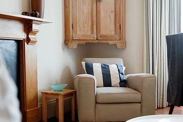 The great sitting-room with additional seating to enjoy the sea views.