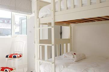 Bedroom 4, this light and bright bunk room has wonderful sea views.