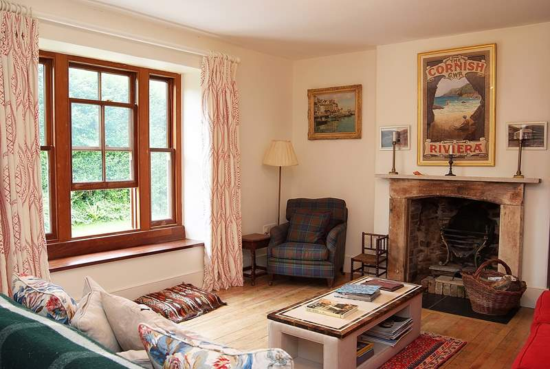 The sitting-room has an open fire and deep window seats.