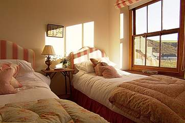 The twin bedroom overlooks the valley towards the sea.