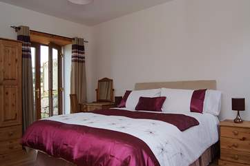 Bedroom 2 has a king-size double bed and an en suite shower-room.