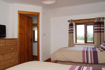 Bedroom 3 (excluded at the lower rent band) has an en suite shower-room and spectacular countryside views.
