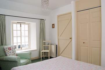 The bedroom is lovely and light.