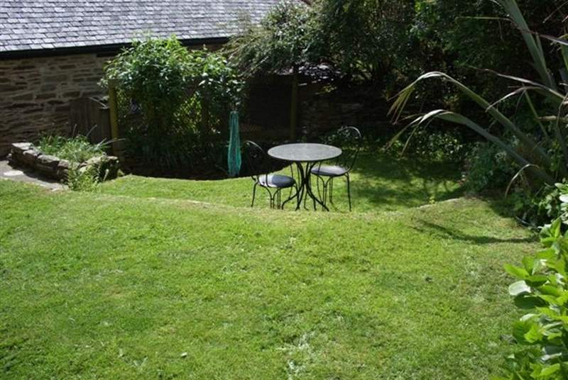 The cottage has a small stone terrace at the front, which captures the morning sun and a sloping garden to the side of the cottage.