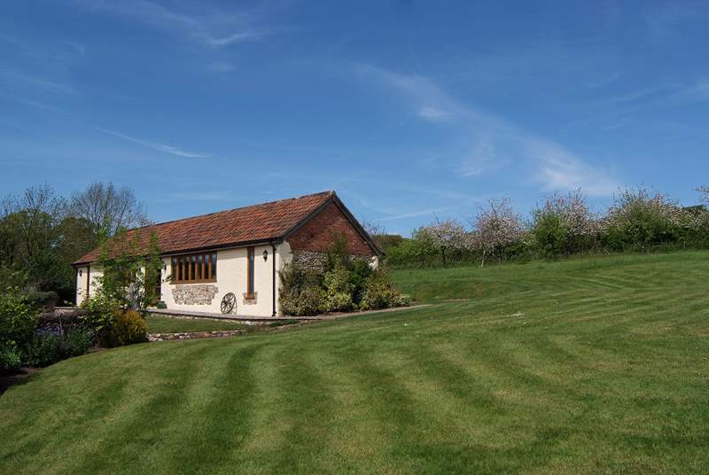 This is The Old Dairy. Set on the edge of a wonderful orchard with all the space you could want.