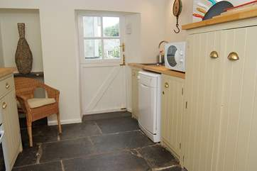 The Cornish slate floor runs through the little kitchen.