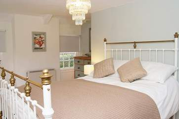 There is a lovely bedstead in bedroom one.